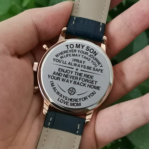 Holding the engraved watch with the perfectly loving messages for son from mom
