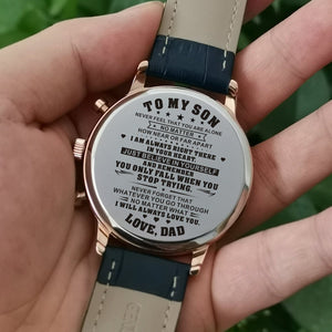 Holding the engraved watch with the perfectly loving messages for son from dad