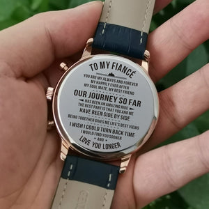 Holding the engraved watch with the perfectly loving messages for fiance