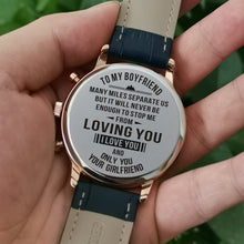 Holding the engraved watch with the perfectly loving messages for boyfriend
