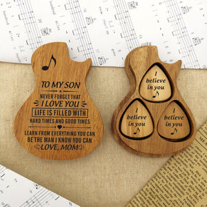 Each guitar pick and the pick case are engraved with meaningful love messages for son