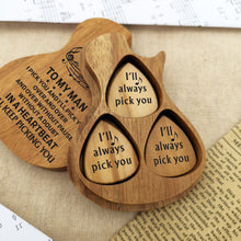 Three guitar picks with meaningful love messages are inside the guitar-shaped wooden box