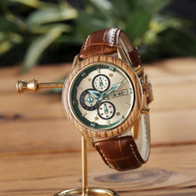 A luxurious watch with brown leather watchband is hanged on a watch hanger