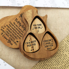 Three guitar picks with meaningful love messages for wife are inside the guitar-shaped wooden box