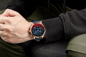 Man wearing the engraved watch with dark blue leather design and long sleeve shirt