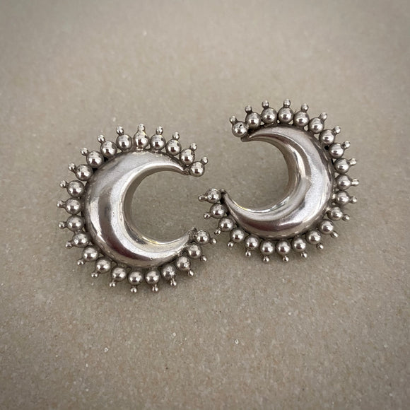 Tribal carved crescent studs