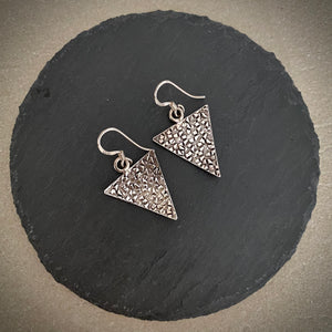 Silver carved triangles