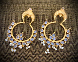 Opulent gold hoops with crystals