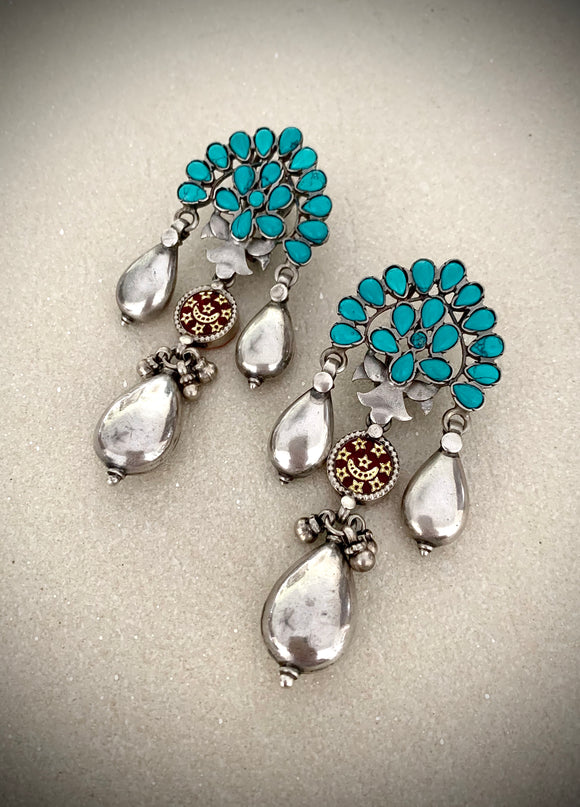 Trendy turquoise half floral drop