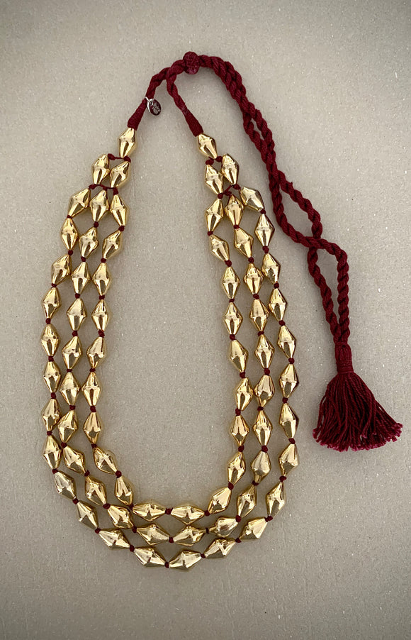 Dholki Beads three strand gold