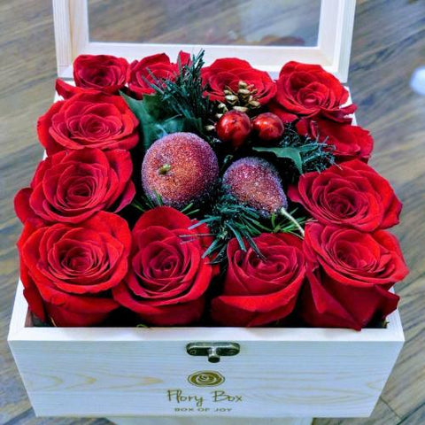 Box of Dozen red roses with festive decoration for new year. Perfect as a gift for yourself or your love ones.