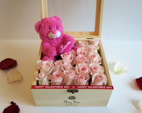 Box of pink roses with a teddy bear for valentine's day in Toronto