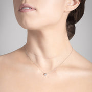 Annie James jewelry diamond and white gold necklace, butterfly charm, thyroid cancer awareness