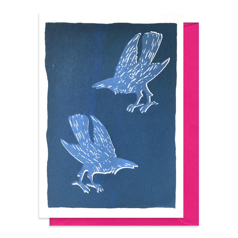 Blue card with a design featuring two screen printed crows