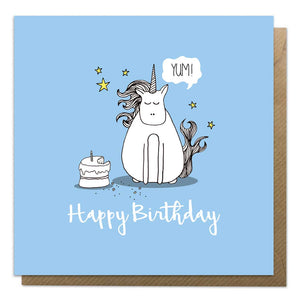Blue birthday card with an illustration of unicorn and cake