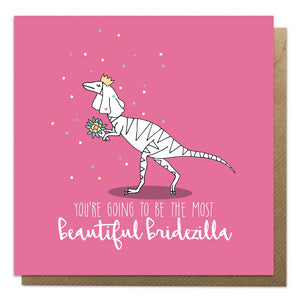 Pink card with an illustration of a dinosaur and the words beautiful bridezilla