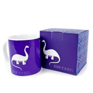Purple dinosaur mug with gift box featuring an illustration of a brontosaurus