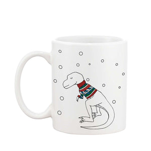 White mug with an illustration of a dinosaur wearing a Christmas jumper