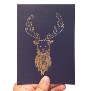 Navy blue card with a gold foil stag illustration