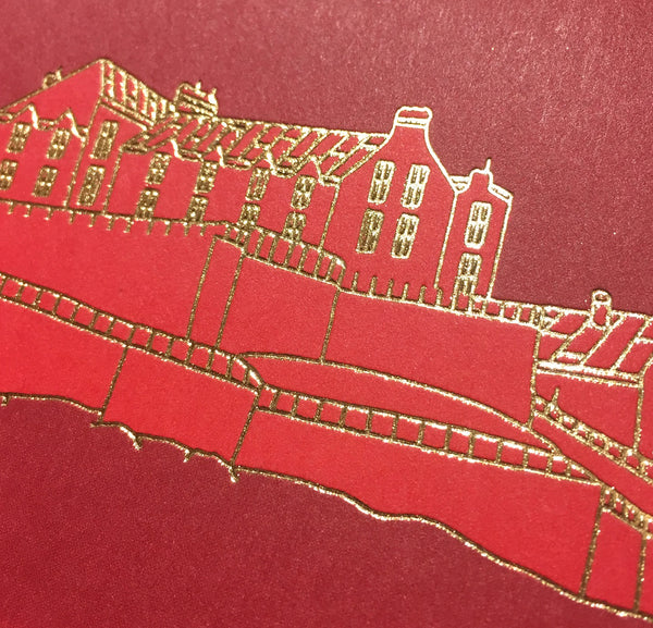 Close up detail of gold foiled Edinburgh castle