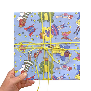 Blue wrapping paper with fairy illustrations