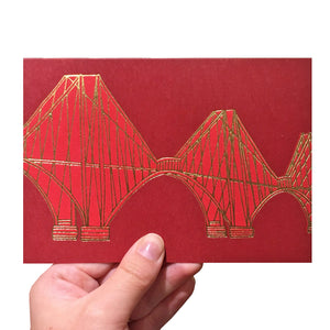 Red greeting card with a gold foiled illustration of the Forth Rail Bridge