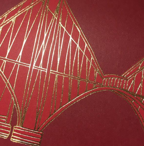 Close up detail of gold foiled Forth Rail Bridge