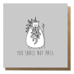 A grey greeting card with an illustration of Gandalf unicorn