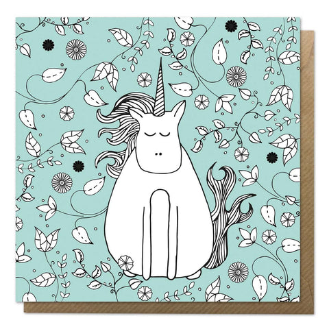 Green greeting card with an illustration of a unicorn in a garden