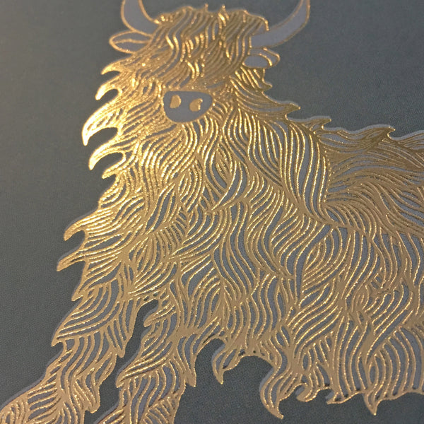Close up detail of gold foiled highland cow