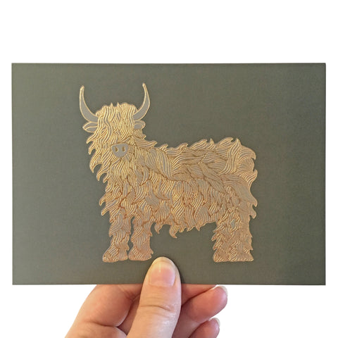 Image of card featuring a beautiful gold foiled highland cow