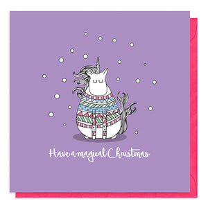 Purple card with an illustration of a unicorn in a Christmas jumper