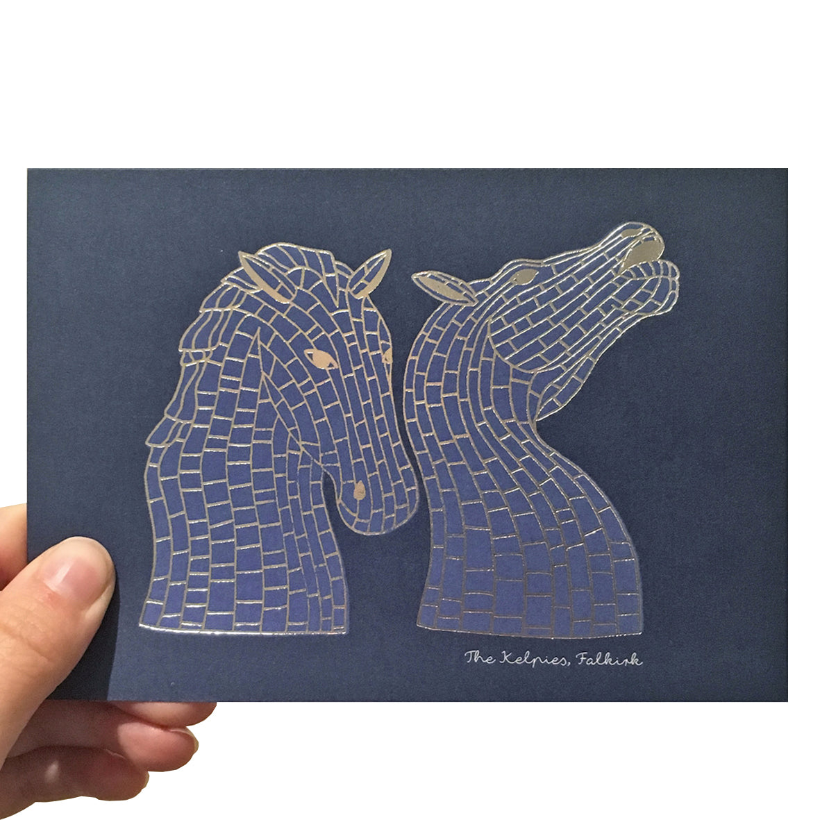 Navy blue card with a silver foil keplies sculpture illustration