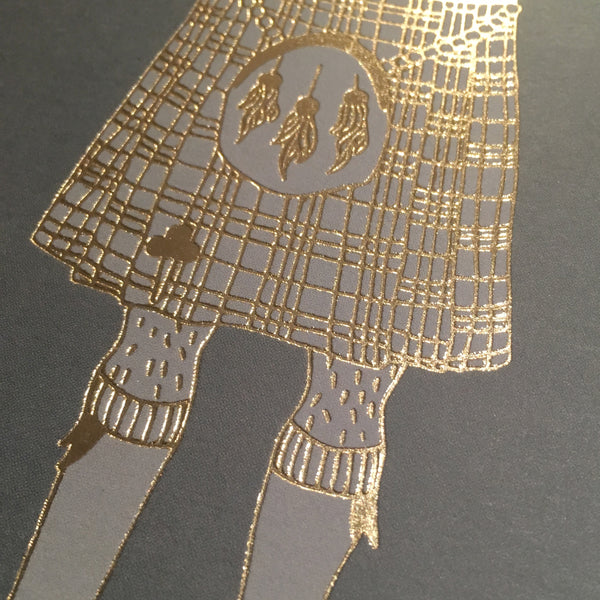 Close up detail of gold foil kilt card