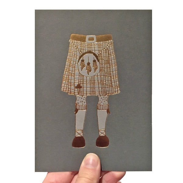 Grey greeting card with an illustration of a kilt printed in gold foil