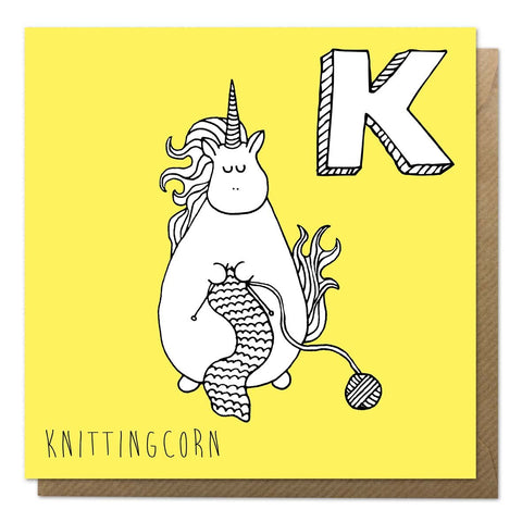Yellow unicorn alphabet card with an illustration of a knitting unicorn