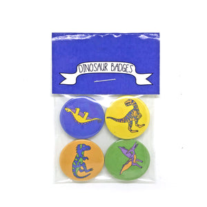 Set of 4 dinosaur badges with pictures of a brontosaurus and stegosaurus