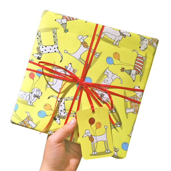 Bright yellow wrapping paper with illustrations of dogs