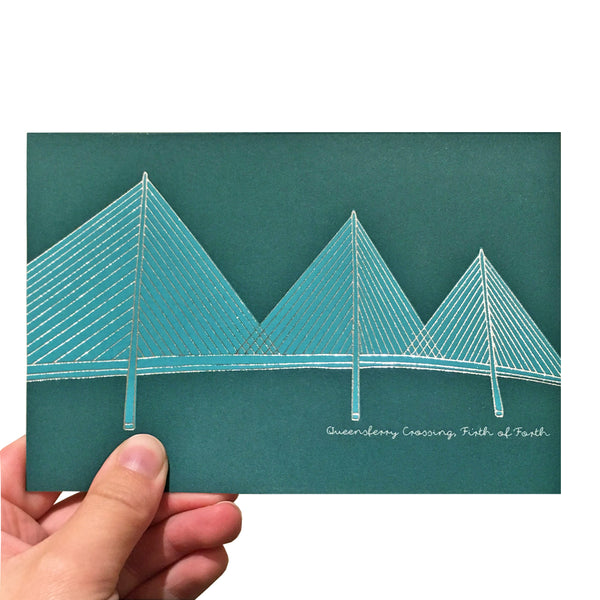Turquoise card with a silver foil illustration of the Queensferry crossing bridge