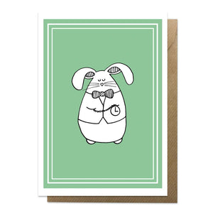 Green greeting card with an illustration of a white rabbit