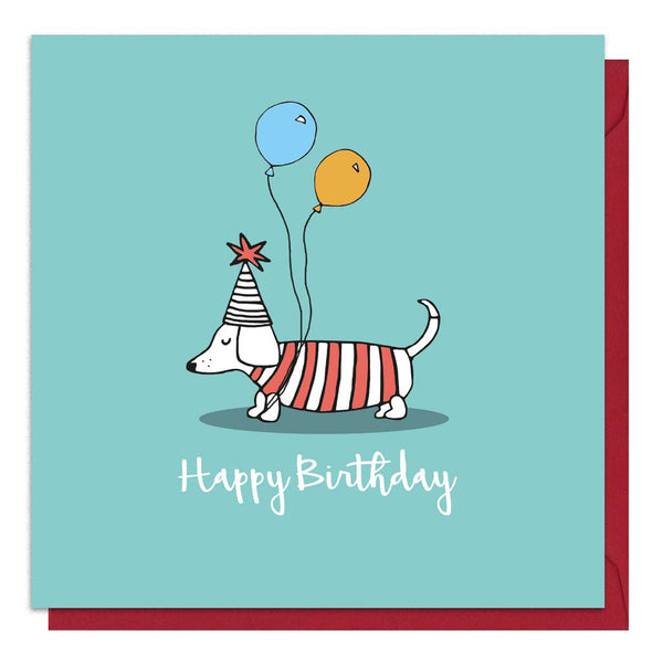 Green birthday card with an illustration of a sausage dog