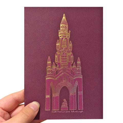Purple greetings card with a gold foil illustration of the Scott Monument