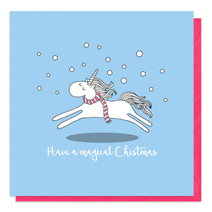 Blue Christmas card with an illustration of a unicorn in snow