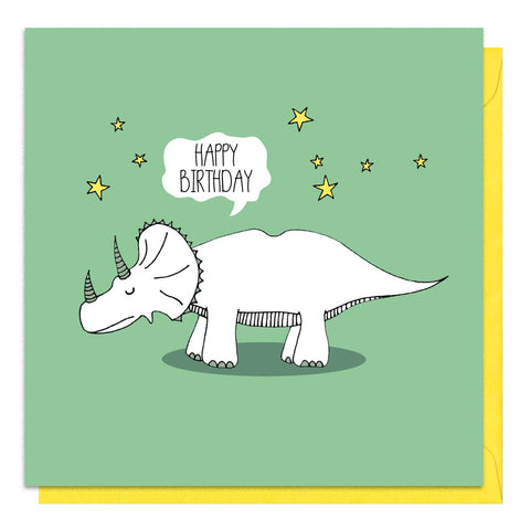 Green birthday card with an illustration of a triceratops