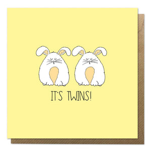 Yellow new twins card featuring two fluffy rabbits