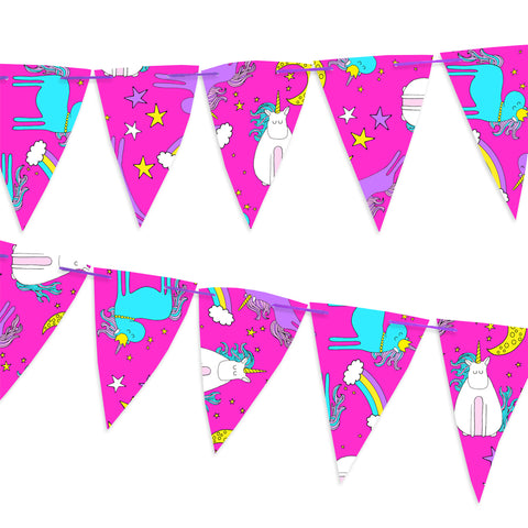 Pink paper bunting covered in unicorns and rainbows