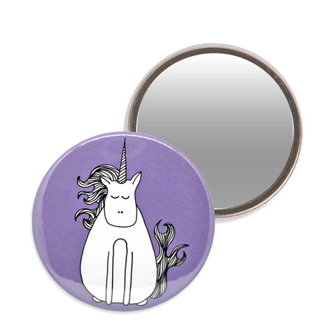 Purple makeup mirror with an illustration of a unicorn. 7.6cm diameter