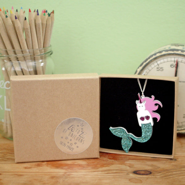 Unicorn mermaid acrylic necklace with a sparkly tail in a brown box