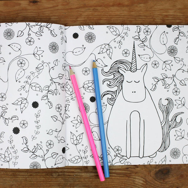 A page from A-Z of Unicorn Colouring Book featuring a unicorn in a garden