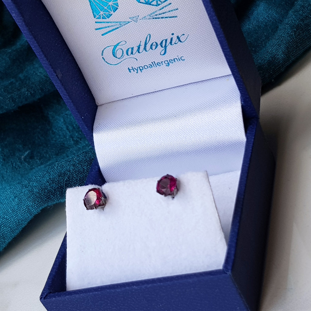 Catlogix boxed garnet stud earrings